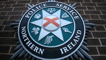 Four masked men were involved in the paramilitary-style attack