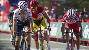 Alberto Contador (c) retains the lead after finishing third