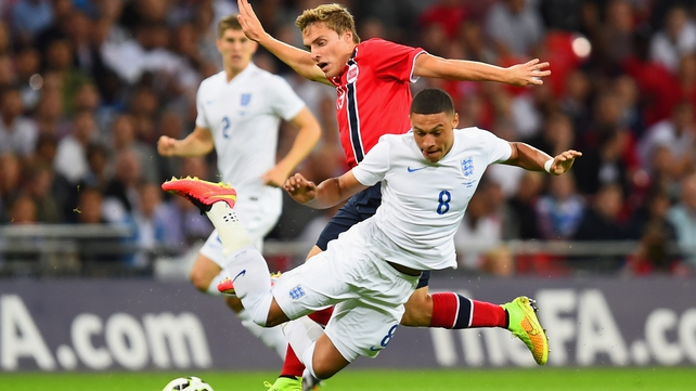 Ruben Yttergard Jenssen of Norway challenges Alex Oxlade-Chamberlain