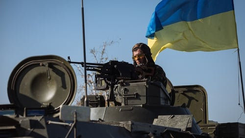 A Ukrainian soldier drives a military vehicle in eastern Ukrainian