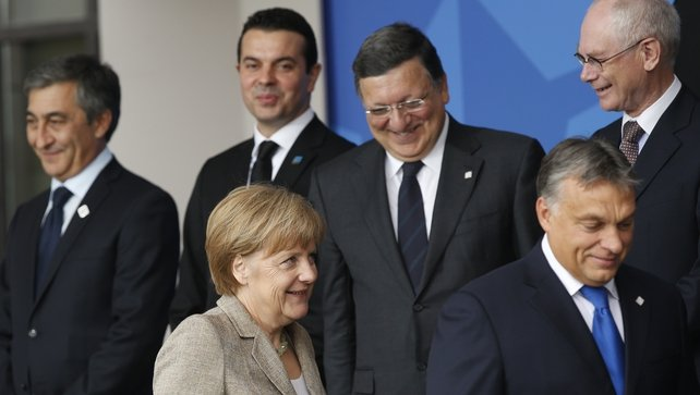 German Chancellor Angela Merkel joins other Heads of State and Government at the start of the NATO Summit in Wales