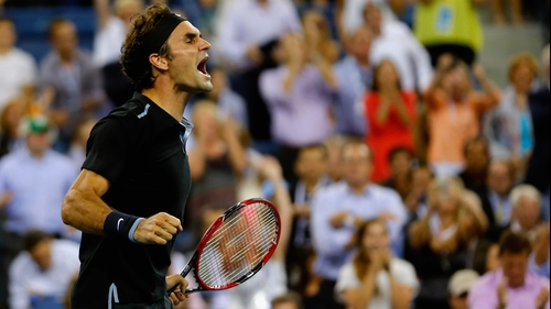 Roger Federer celebrates reaching the semi-finals at the US Open for the first time since 2011