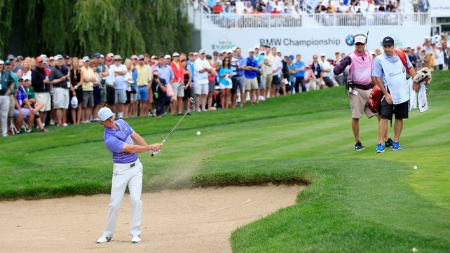 Rory McIlroy escapes from the bunker on the eighth hole at Cherry Hills