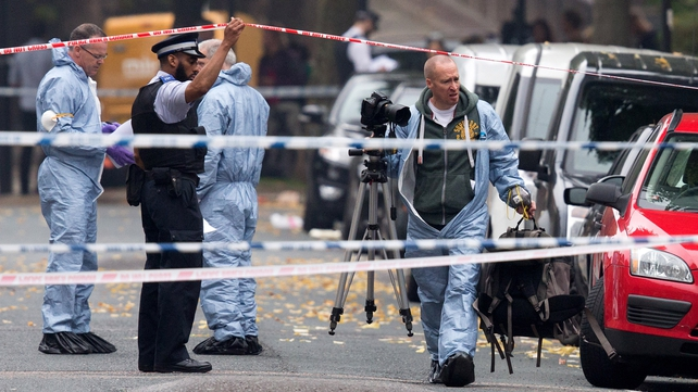 Forensic investigators prepare to examine the property in Islington, north London
