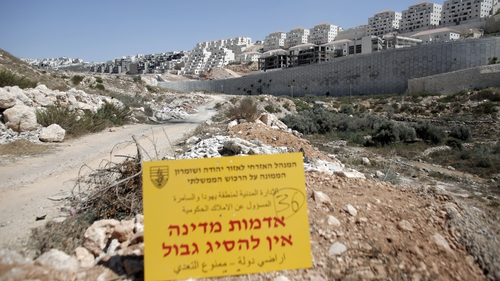 An official Israeli sign from the Civil Administration in Charge of the Government Property, placed in the West Bank near the Israeli Beitar Illit (R) settlement