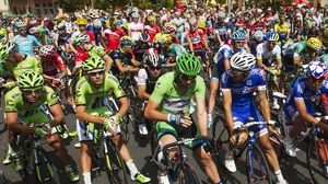 Cyclists wait for the start of the 13th stage of the 69th edition of La Vuelta