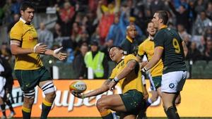 Israel Folau celebrates scoring Australia's first try