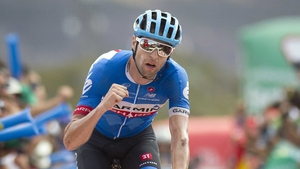 Ryder Hesjedal celebrates as he crosses the finish line to win the 14th stage