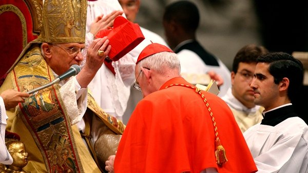 New Cardinal Seán Brady receives the biretta, a four-cornered red hat, from Pope Benedict XVI during the Consistory ceremony in St Peter's Basilica at the Vatican in November 2007