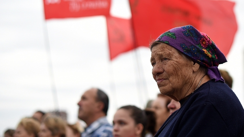 People take part in a Pro-Russian rally in Donetsk