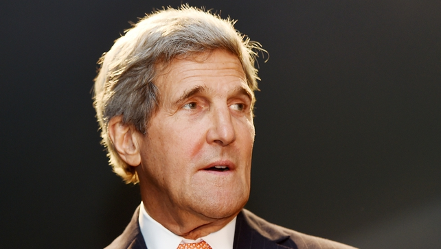 """John Kerry said Washington would stand """"shoulder to shoulder"""" with the Iraqis"""