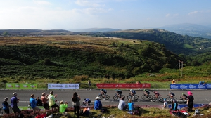 The peloton make their way up the final climb during stage three from Newtown to Abergavenny in Wales