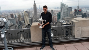 Marin Cilic poses with his prize in New York