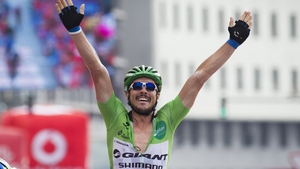 John Degenkolb celebrates as he crosses the line first, again