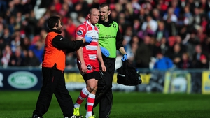 Gloucester rugby player Mike Tindall is escorted from the field for a concussion assessment during a game last season