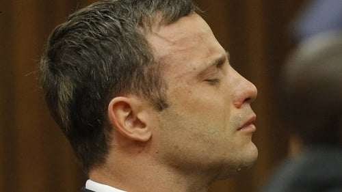 Oscar Pistorius sits in the Pretoria High Court