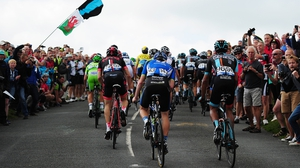 The peloton make their way up the final 100m to the submit of Hay Tor during stage five from Exmouth to Exeter