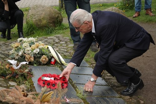 Harry Callan laying wreath and crosses at Bunker Valentin in memory of his Irish comrades
