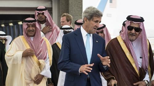 US Secretary of State John Kerry speaks with Prince Saud al-Faisal (R), foreign minister of Saudi Arabia, at King Abdulaziz International Airport