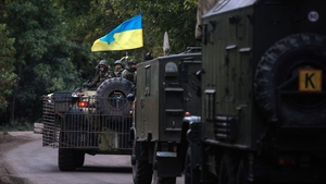 A military vehicles drive on a road in Kramatorsk town, near Slaviansk, Ukraine