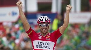 Australian cyclist Adam Hansen celebrates as he crosses the finish line