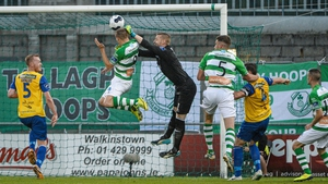 Shamrock Rovers' Karl Sheppard beats Dundalk goalkeeper Peter Cherrie to the ball and heads home, only for the referee to rule out his effort for offside