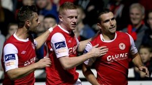 Christy Fagan celebrates with Greg Bolger and Sean Hoare after scoring the Saints' first goal