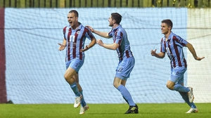 Drogheda's Mick Daly (l) celebrates after scoring his side's second goal with team-mates Ciaran McGuigan and Gavan Holohan