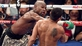 Mayweather Jr retains titles after feisty fight