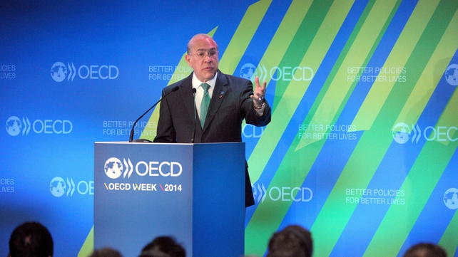 OECD's director general Angel Gurria cuts growth forecasts for most advanced economies