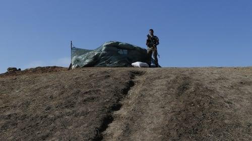 Ukrainian soldiers guard a check point near Mariupol