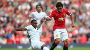 Rafael of Manchester United is tackled by David Hoilett of QPR - Rafael received a frank judgement from Eamon Dunphy