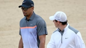 Tiger Woods would take the attention and pressure away from Rory McIlroy, according to Paul McGinley