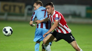 Derry's Dean Jarvis gets the better of Cathal Brady of Drogheda