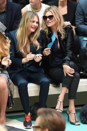 Cara Delevingne and Kate Moss at Burberry Prorsum