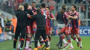 Bayern players celebrate Jerome Boateng's late winner
