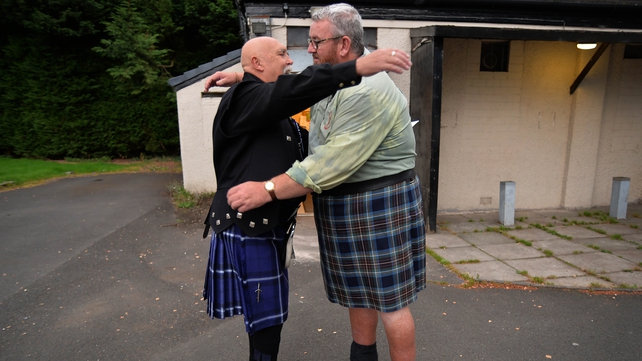 Two Yes campaigners embrace at a polling station in Renton
