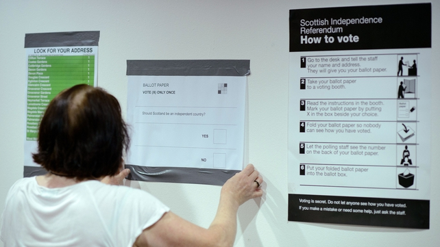 With many teenagers set to vote for the first time, a polling station worker makes final preparations