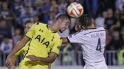 Bentaleb Nabil (left) of Tottenham jumps for the ball with Miroslav Vulicevic (right) of Partizan