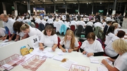 Postal votes are checked at the count centre in Aberdeen
