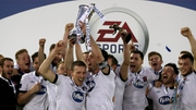 Dundalk captain Mark Rossiter lifts the EA Sports Cup