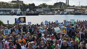 Enviromental protesters gather in a park in Sydney as part of a global protest on climate change
