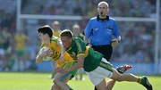 Brian Sugrue of Kerry tries to dispossess Donegal's Colm Kelly