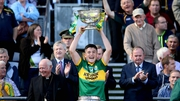 Kerry captain Liam Kearney lifts the cup after the four-point victory