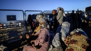 Syrian Kurds wait at border to pass into Turkey
