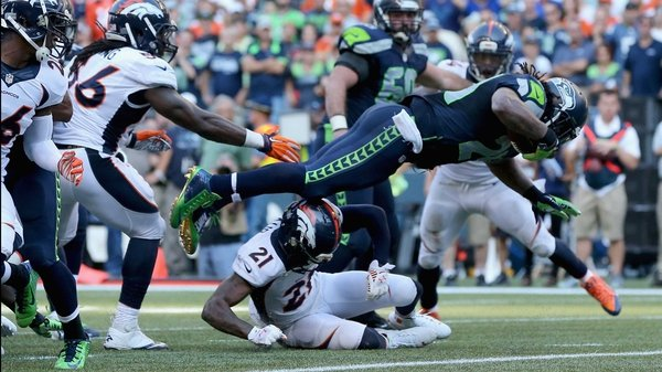 Marshawn Lynch leaps into the endzone to claim victory for the Seahawks at CenturyLink Field in Seattle