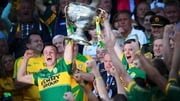 Kerry's Fionn Fitzgerald and Kieran O'Leary lift the Sam Maguire cup