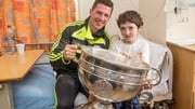Kerry's Kieran O'Leary and Gary Monaghan from Louth with Sam Maguire