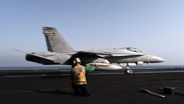 An F/A-18C hornet takes off from the flight deck of the US navy aircraft carrier USS George HW Bush in the Gulf