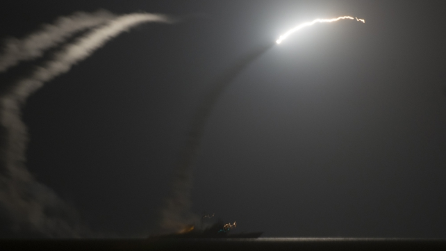 US missile cruiser launches a cruise missile against Islamic State targets in Syria